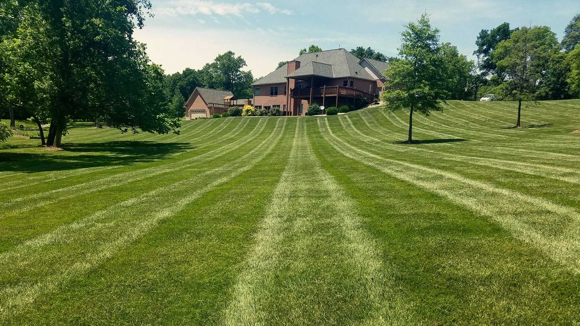 Professional mowing services at a home in Alton.