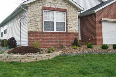 Landscape design with rock at a home in Alton.