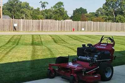 Element Turf & Outdoor Solutions, LLC lawn mower with perfectly mowed grass in Alton, IL.