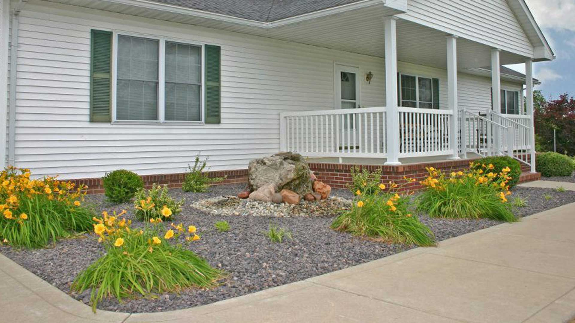 New landscaping - curbing, plants, shrubs, and rock at Alton, IL home.