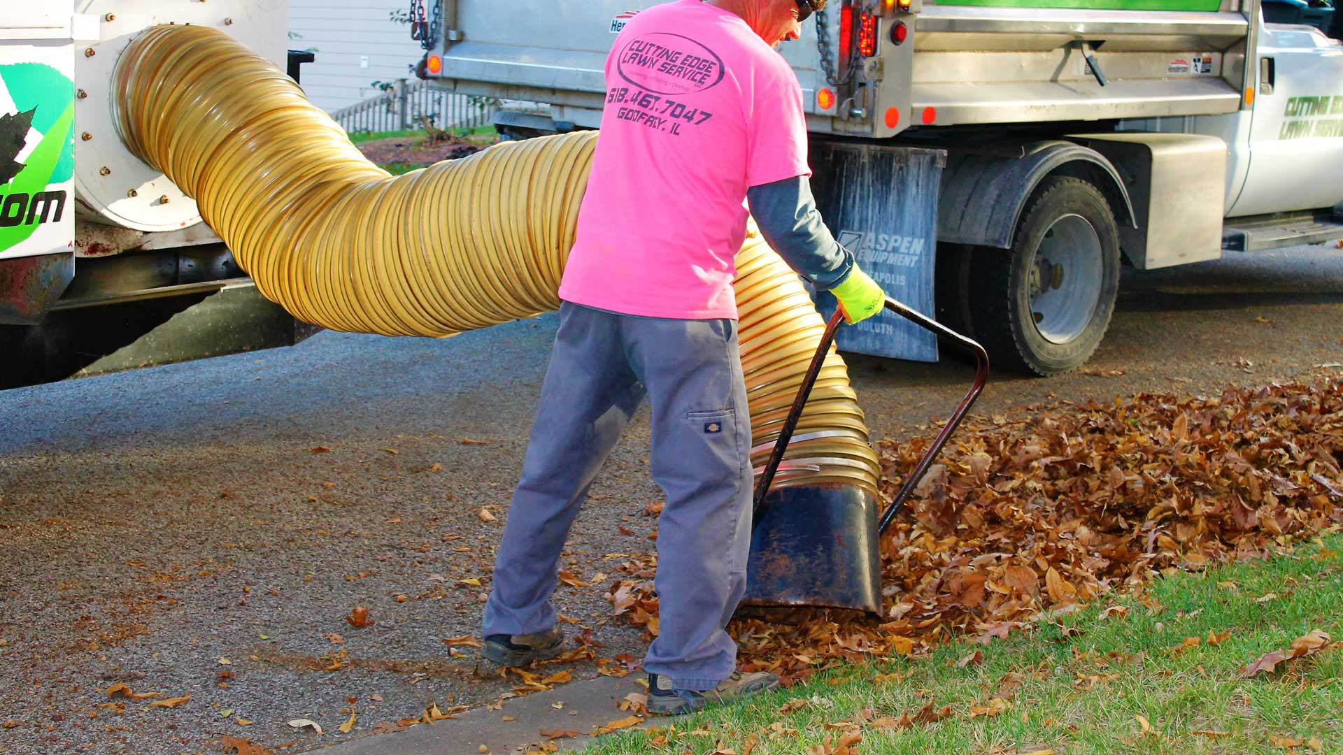 Element Turf & Outdoor Solutions, LLC leaf removal truck vacuuming up leaves in Godfrey, IL.