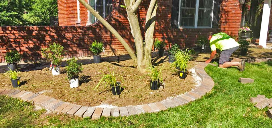 Element Turf & Outdoor Solutions, LLC installing new landscaping at a home in Alton, IL.