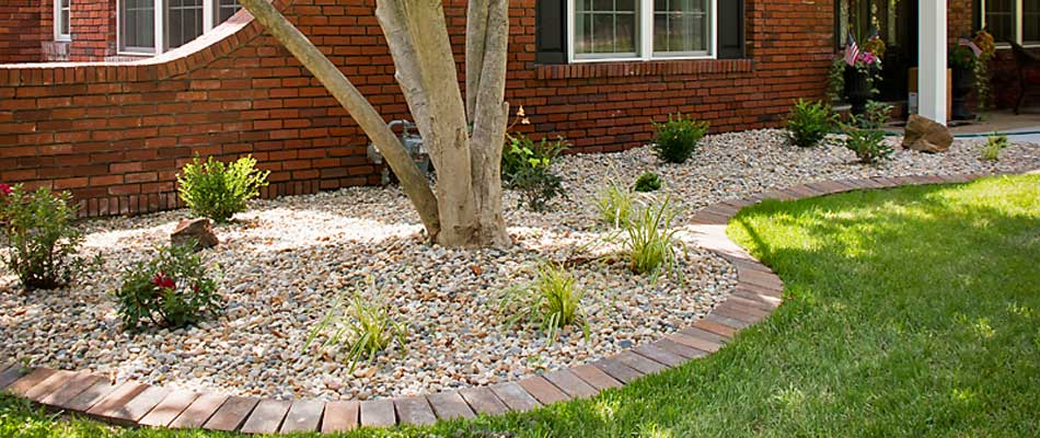 New Iowa River Rock installed in landscaping bed at Alton, IL home.