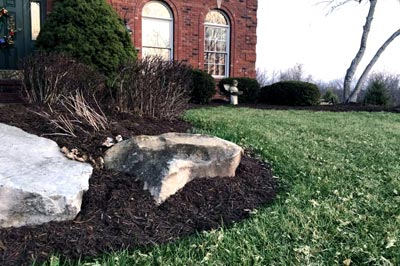 New landscaping with mulch at a home in Alton.